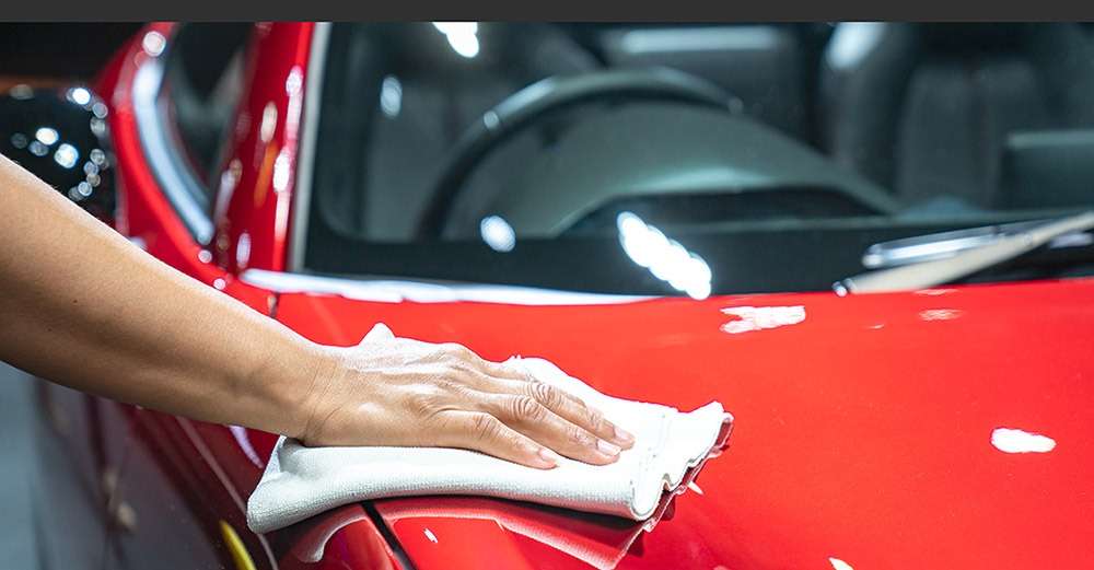 Veloce Vault Red Car being detailed