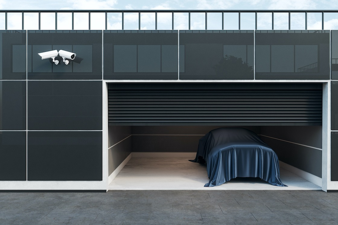 Car in a storage facility with video surveillance.