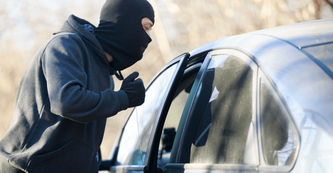 A criminal breaks into a car left at home while the owners are on vacation.