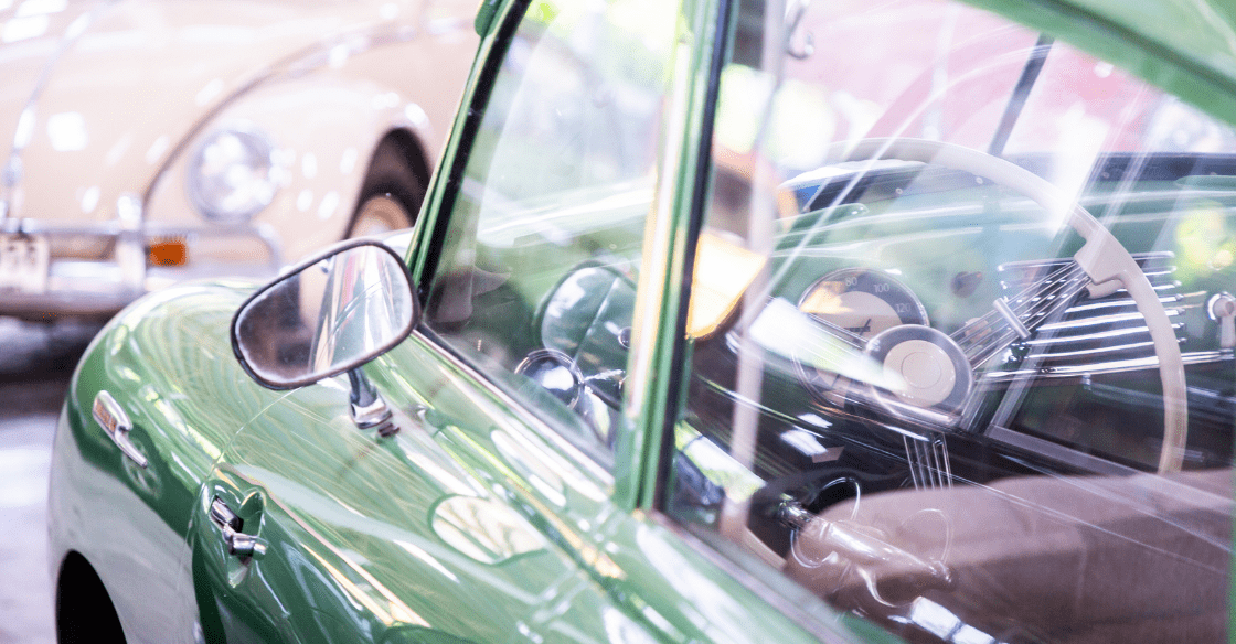 control wheel inside green classic car