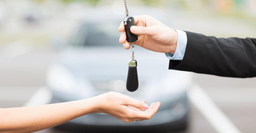 Customer and salesperson with car key