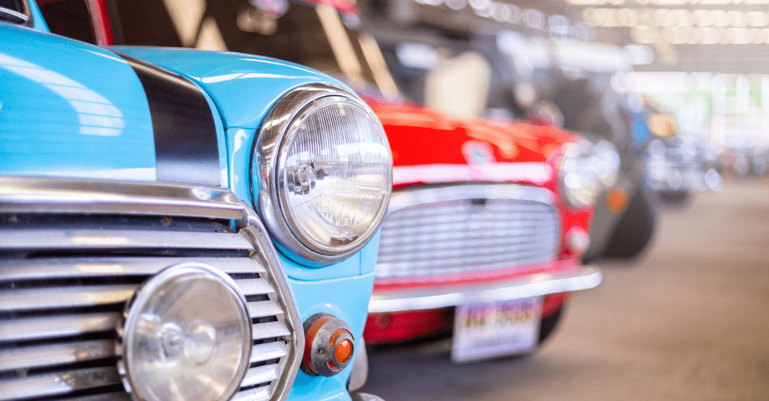 close up classic headlight of vintage car in old garage