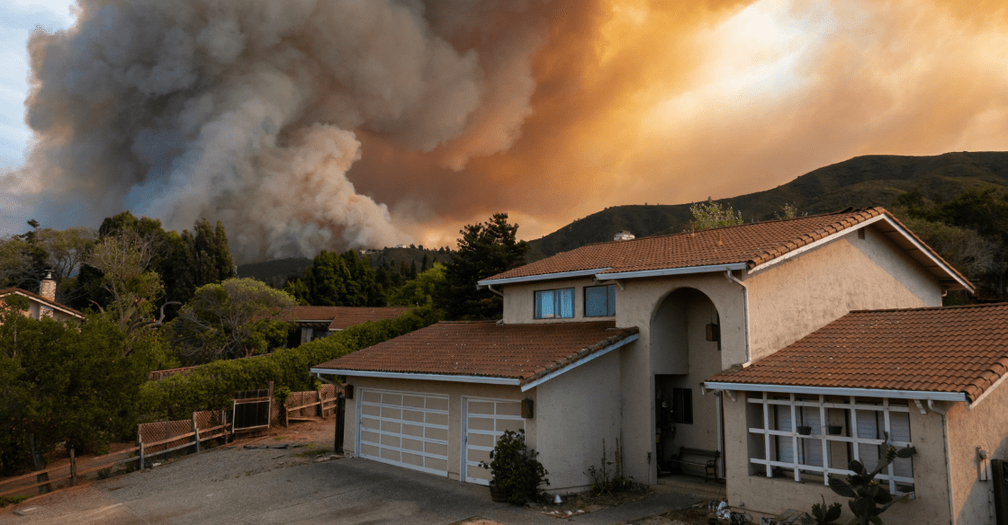 House with wildfires in the background